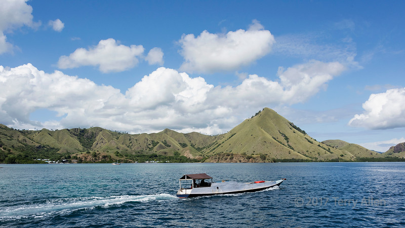 Fishing boat and village along the coast of Labuanbajo, East Nusa Tenggara Island, West Flores, Indonesia