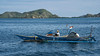 Pair of wooden outrigger fishing boats with long tail engine under deck cowling, off Labuanbajo, West Flores, Indonesia