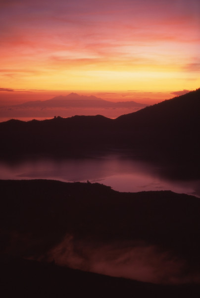 Sunrise from Mount Batur, Bali with Mt. Rinjani, Lombok, Indonesia.