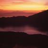 Sunrise from Mount Batur, Bali with Mt. Rinjani, Lombok, Indonesia.