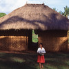 Girl leaves home for school, Pero, Sumba, Indonesia.