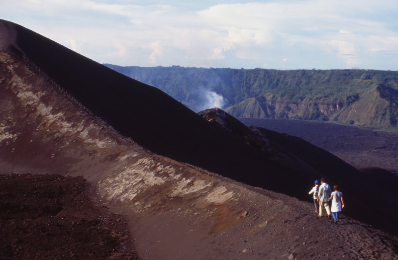 Travelers and guide walking on Mount Batur, Bali, Indonesia.