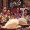 Women winnow rice, Sumba, Indonesia.