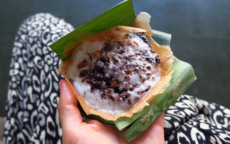 Eating serabi (coconut pancakes) in Solo.