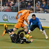St. Louis Ambush forward GORDY GURSON (3) is taken down from behind by Wichita B-52s defender KEVIN TEN EYCK (16) earning a shootout during a regular season Major Arena Soccer League (MASL) game between the St, Louis Ambush and the Wichita B-52's  played at the Family Arena in St. Charles, MO., where Wichita defeats St. Louis by the score of 9-8 in overtime