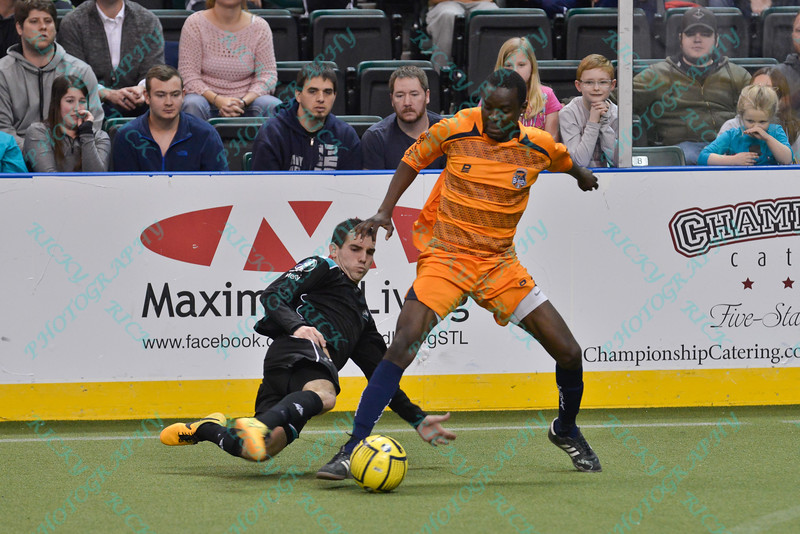 St. Louis Ambush forward GORDY GURSON (3) slides to knock the ball away from Wichita B-52s midfielder ABEL SEBELE (24) during a regular season Major Arena Soccer League (MASL) game between the St, Louis Ambush and the Wichita B-52's  played at the Family Arena in St. Charles, MO., where Wichita defeats St. Louis by the score of 9-8 in overtime