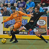 St. Louis Ambush forward ELVIR KAFEDZIC (9) attempts to knock the ball away from Wichita B-52s defender ANTHONY SCOGNAMILLO (19) during a regular season Major Arena Soccer League (MASL) game between the St, Louis Ambush and the Wichita B-52's  played at the Family Arena in St. Charles, MO., where Wichita defeats St. Louis by the score of 9-8 in overtime