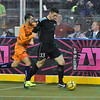 St. Louis Ambush forward ADNAN GABELJIC (33) uses his arms to block out Wichita B-52s midfielder TICO RODRIQUEZ (15) from the ball during a regular season Major Arena Soccer League (MASL) game between the St, Louis Ambush and the Wichita B-52's  played at the Family Arena in St. Charles, MO., where Wichita defeats St. Louis by the score of 9-8 in overtime