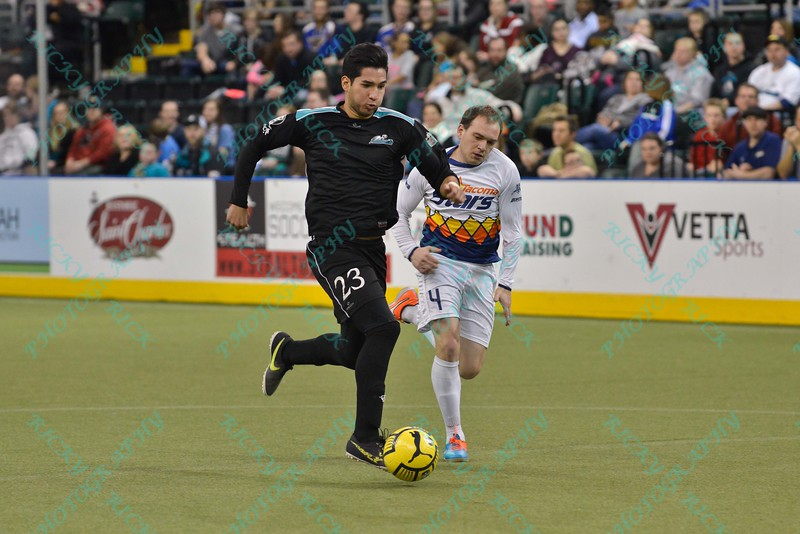 St. Louis Ambush defender AXEL DURANTE (23) sprints with the ball in front of Tacoma Stars defender VITALIE BULALA (4) during a regular season Major Arena Soccer League (MASL) game between the St, Louis Ambush and the Tacoma Stars played at the Family Arena in St. Charles, MO., where St. Louis defeats Tacoma by the score of 13-3