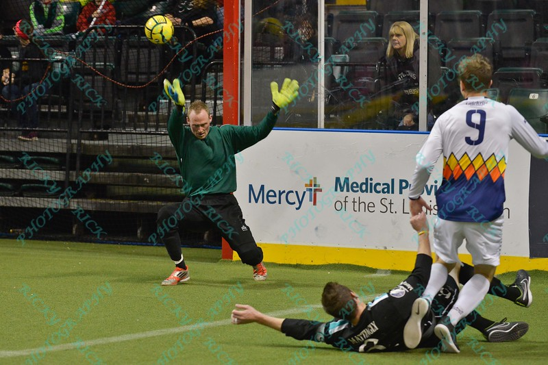 Tacoma Stars forward DEREK JOHNSON (9) fires the ball past St. Louis Ambush goalie ALAN HAGERTY (0) for a goal despite the sliding block attempt of St. Louis Ambush defender CHRIS MATTINGLY (6) during a regular season Major Arena Soccer League (MASL) game between the St, Louis Ambush and the Tacoma Stars played at the Family Arena in St. Charles, MO., where St. Louis defeats Tacoma by the score of 13-3