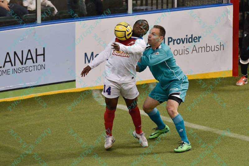 Missouri Comets forward LEO GIBSON (14) tries to control the ball while being defended by St. Louis Ambush midfielder JEFF DIMARIA (8) during a regular season Major Arena Soccer League (MASL) game between the St, Louis Ambush and the Missouri Comets played at the Family Arena in St. Charles, MO., where Missouri Comets defeat St. Louis by the score of 10-5