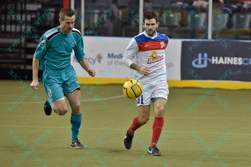 St. Louis Ambush forward ROSS MACGREGOR (77) and Missouri Comets midfielder JOSH GARDNER (31) during a regular season Major Arena Soccer League (MASL) game between the St, Louis Ambush and the Missouri Comets played at the Family Arena in St. Charles, MO., where Missouri Comets defeat St. Louis by the score of 10-5
