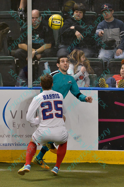 St. Louis Ambush forward GORDY GURSON (3) looks to make a play on the ball while being defended byMissouri Comets defender BRAIN HARRIS (25) during a regular season Major Arena Soccer League (MASL) game between the St, Louis Ambush and the Missouri Comets played at the Family Arena in St. Charles, MO., where Missouri Comets defeat St. Louis by the score of 10-5