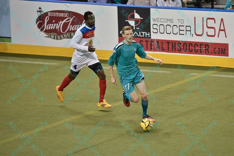 St. Louis Ambush forward ROSS MACGREGOR (77) and Missouri Comets defender ALAIN MATINGOU (4) during a regular season Major Arena Soccer League (MASL) game between the St, Louis Ambush and the Missouri Comets played at the Family Arena in St. Charles, MO., where Missouri Comets defeat St. Louis by the score of 10-5