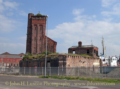 The last remains of the high level coal railway and pumping station at Bramley-Moore Dock. The high level railway, served from the former Lancashire and Yorkshire Railway network closed in 1966. Most of the substantial brick stucture being demolished around 1991. The high level coal railway should not be confused with the Liverpool Overhead Railway.