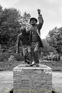 The bronze sculpture of a miner and rescuer was unveiled on the 100th Anniversary of the Senghenydd Disaster - at 08:10 on October 14, 2013. it was designed by sculptor Les Johnson.
