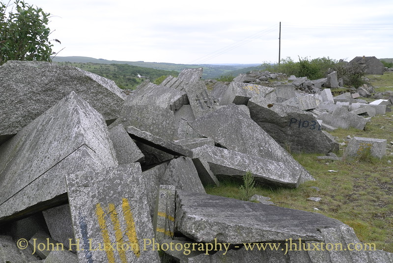 Merrivale Quarry, Dartmoor closed in 1997, In its final years it had been operated by the Tarmac Group. The Quarry, the last working granite quarry on Dartmoor was famous for producing the Falklands Island War Memorial commemorating the Falklands War of 1982.  Much of the quarry equipment was removed by scrap merchants in 2007. Around the quarry can be seen some remains of finished and partly finished stone, some still bearing marks and one or two prices.  These photographs were taken on June 01, 2011