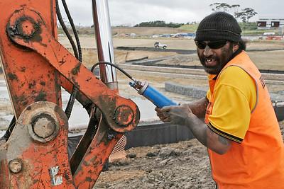 Mack, a digger driver doing some maintenance.