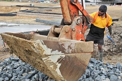 Mack tending to his digger.