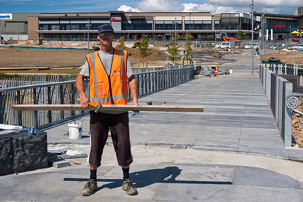 Nigel and the nearly complete bridge - its mostly tiled and the railings are up. The circular centre tiling is still to be done - in the depression behind him. He asked for this as a memory photo.