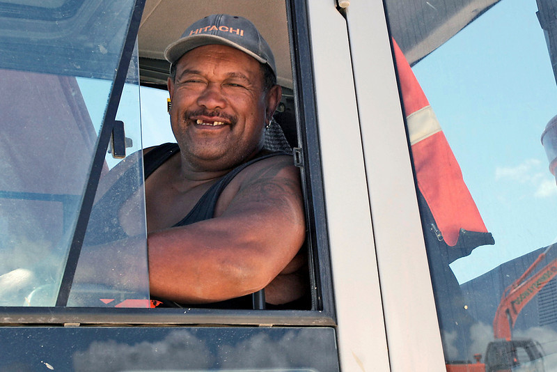 One of the digger drivers shares a friendly smile as he goes about his business.