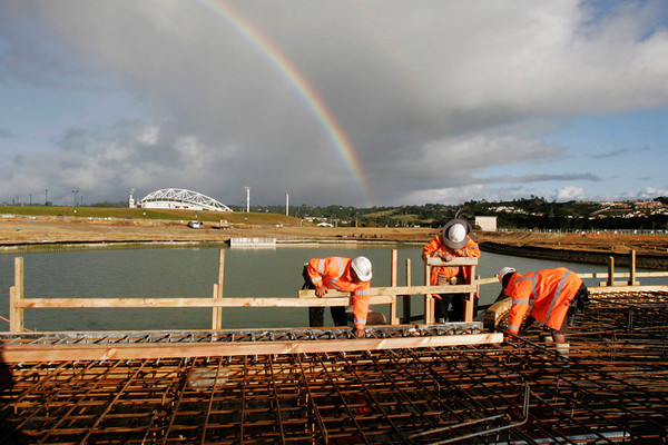 Somewhere over the rainbow .... work goes on.... here it's early morning on the bridge boxing. Behind is the concrete overflow /outlet.