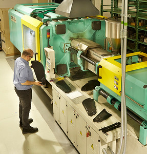 Engineer checks tollerance of injection molded tooling.