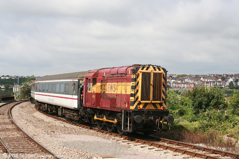 Substituting for the failed 47768, 08511 arrives at Barry Island with the 1138 from Woodham Halt on 26th August 2007.