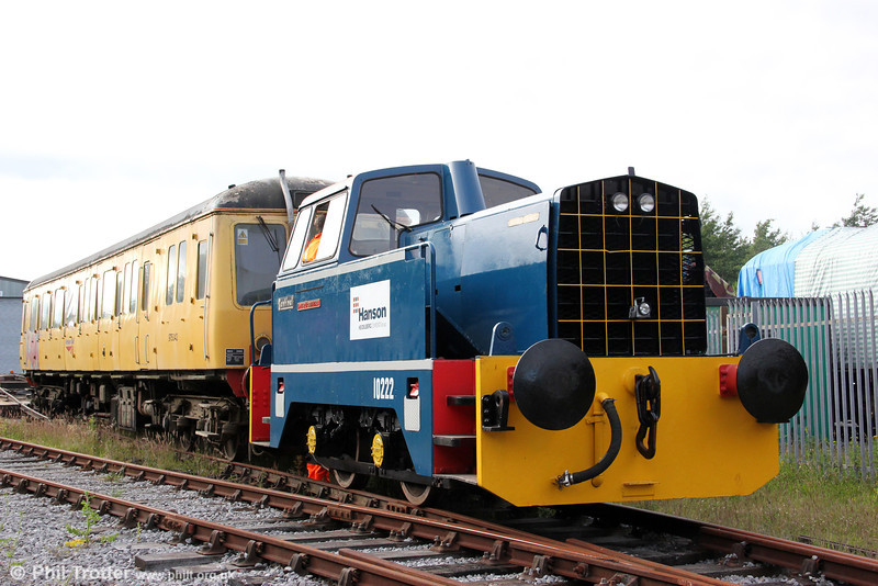 The L&MMR's Sentinel 4wDH (10222/1965) has been restored to Hanson livery and named 'Peter J Griffiths'. The loco is seen shunting newly arrived class 122 single-car unit no W55019 at Cynheidre on 23rd July 2012.