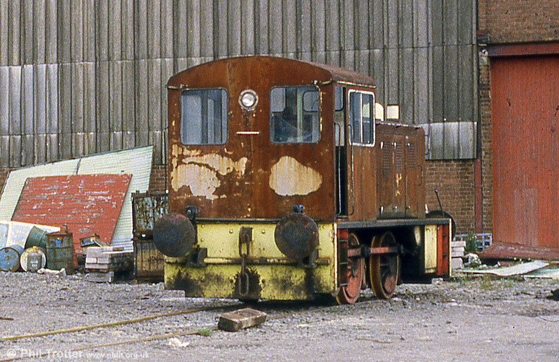 A rusty North British 0-4-0DH no. 28038 of 1961 at Norbrit Wharfage, Briton Ferry in August 1985. The loco was formerly with Cadbury's, Bournville (no. 15). Its remains were reportedly shipped abroad as scrap in 2004.