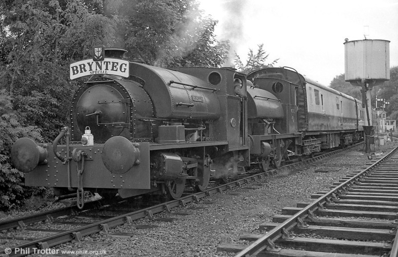 Peckett 0-4-0ST (1967/1939) 'Merlin/Myrrdin' and RSH 0-4-0ST (no.7058/1942) 'Olwen' depart from Bronwydd Arms, Gwili Railway, with a dining train for Llwyfan Cerrig on 18th July 1987.
