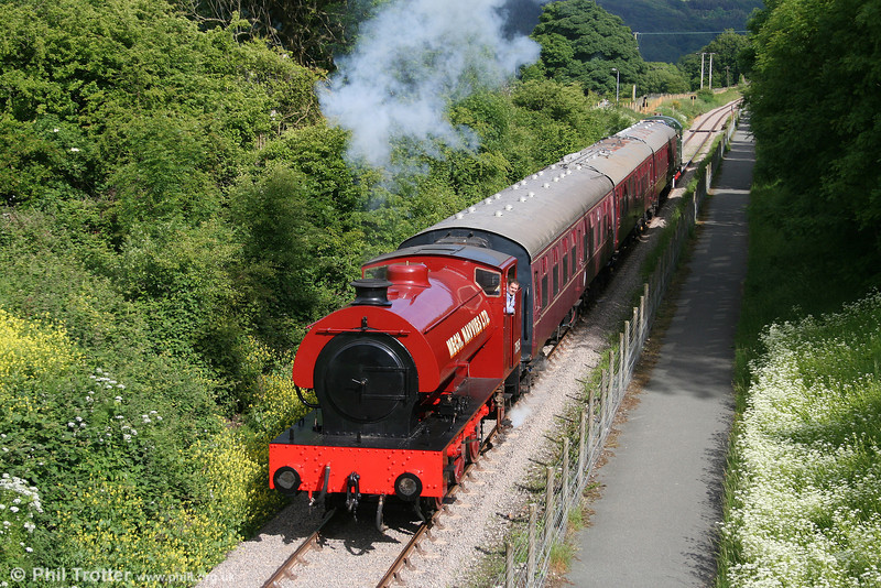 On the newly extended Pontypool & Blaenavon Railway, RSH Austerity 0-6-0ST no. 7169 of 1944 heads the final train of the day, the 1700 Blaenavon High Level to Furnace Sidings on 20th June 2010. The loco (WD 71515) spent its industrial career with the NCB at Ashington and other collieries around Durham.