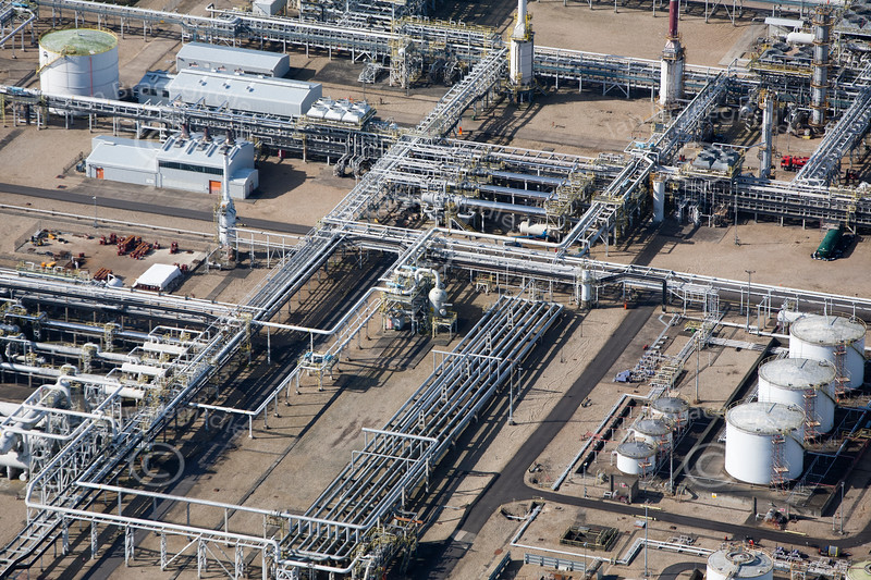 A stock aerial photo of a pipes and storage tanks used in refineries.