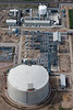 A stock aerial photo of a storage tank used in refineries.