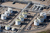 Aerial photography of a pipes and storage tanks in a refinery.