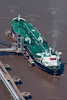 An aerial photo of a tanker at a mooring.