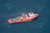An aerial photo of a small supply ship in the North Sea.