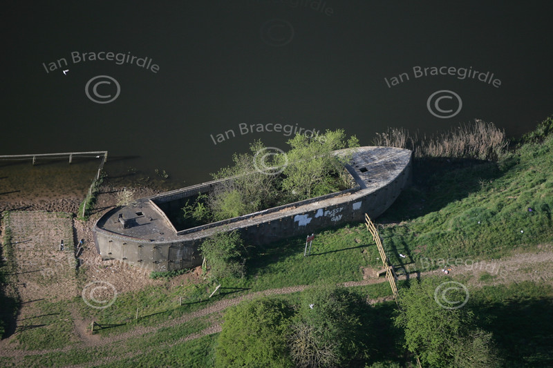 Aerial photo of an old barge which is grounded.