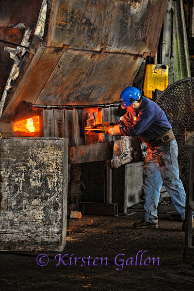 A worker at another section of the forging plant.