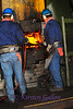 These guys hold on to one of the heated cylinders while the hammer repeatedly comes down on it forging it into it's new shape.