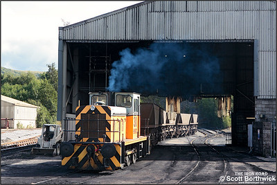 Harry Needle Railway Company (HNRC) No. 30 draws a rake of empty HAA's through the coal discharge shed at Hope cement works on 16/09/2005 after unloading.