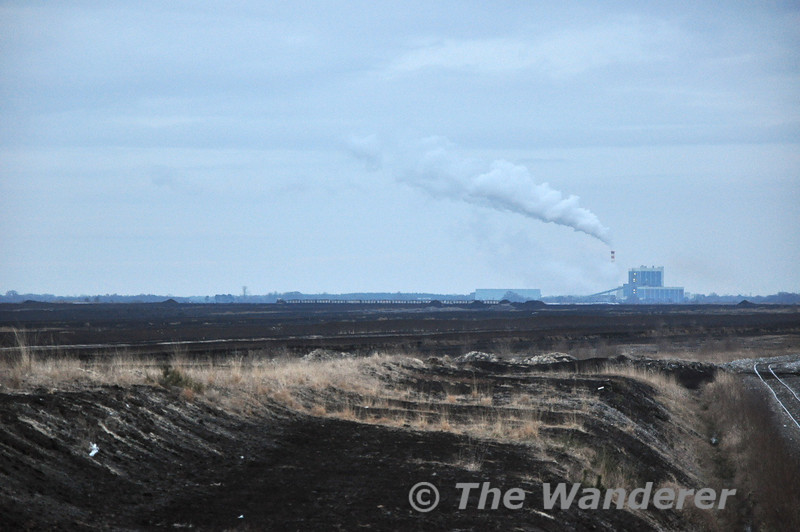 Looking across Esker Moor Bog and Edenderry Power Station in the distance a Peat Train can be seen in the Bog heading to the loading point. Sat 20.02.10