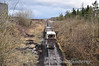 LM422 brings a train of empties from Edenderry to Newtown Bog passes Ballycon Works. Sat 27.02.10