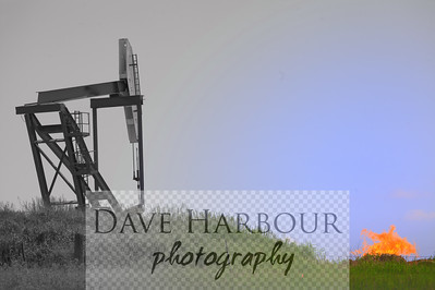 North Dakota oil pump with natural gas safety flare pit in background, focal color on flame and b&W art print.