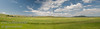 A typical southern Alberta ranching landscape - notice the Rockies in the background.  This panorame is composed of 3 frames.11768 px x 3386 px
