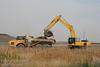 A shovel loading trucks at a new development in Calgary
