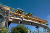 The Calgary West LRT's massive yellow launching truss lifts 24-tonne guideway segments into place above 14 th Street S. Until early 2011, the truss will be at work constructing the 1.5 kilometre elevated guideway between Shaw Millennium Park and Crowchild Trail.