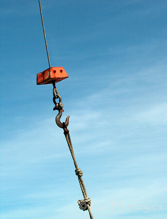 Winch hook with blue sky and wispy clouds..  © Rob Huntley