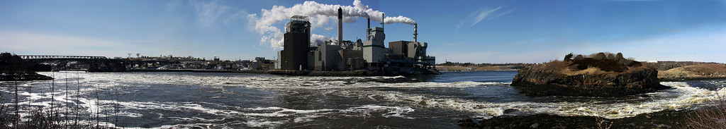 Industrial River - View of the paper mill at reversing falls, Saint John, New Brunswick, Canada.