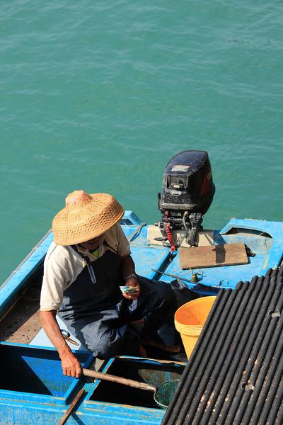 Local fisherman, Sok Kwu Wan, Lamma Island, Hong Kong